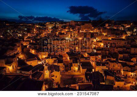 Matera Panoramic View Of Old Town At Night, Basilicata, Italy. Buildings, Ancient. European Capital