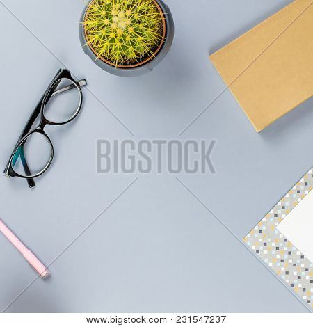 Flat Lay Home Office Desk. Female Workspace With Note Book, Eyeglasses, Tea Mug, Diary, Plant. Copy