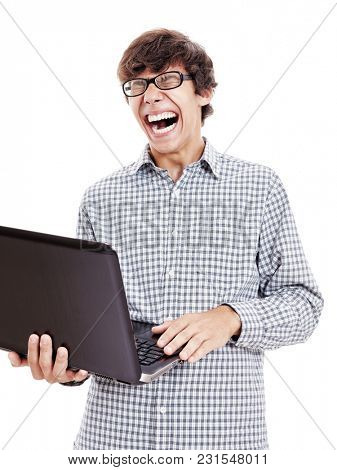 Young hispanic man wearing blue checkered shirt and black glasses holding laptop in his hand and loudly laughing with closed eyes isolated on white background - fun, humor and internet memes concept