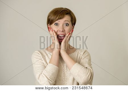 Young Happy And Surprised Red Hair Woman Looking To Camera Delighted Astonished And In Surprise Face