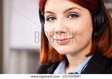 Close Up Portrait Of Woman With A Headset On