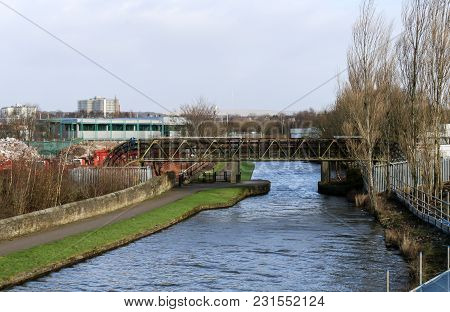 A Metal Bridge Carrying Pipes Over The Canal In Wigan
