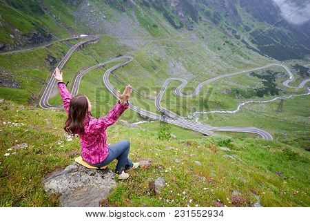 Young Female Lifting Hands To The Sky Admiring The Beauty Of Green Rocks And Mountains And One Of Wo