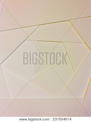 Abstract Geometric Background In Light Pastel Tones From Sheets Of Thick Pale Pink, Yellow Paper, Ca
