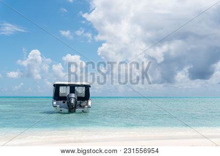 Speedboat On Clear Transparent Water Of Ocean In Maldives