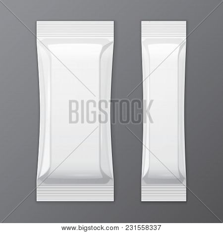 Two White Blank Foil Packaging On Gray Background Sachet Coffee, Salt, Sugar, Pepper Or Spices Stick