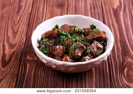 Liver And Spinach Stew In A Bowl