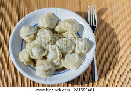 Traditional Russian Dumplings, Homemade Meat Dumplings In A White Plate