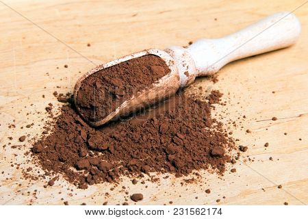 Cocoa Powder On Wooden Background, Copy Space
