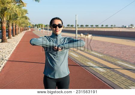 Girl Warming Up On A Running Track Before Workout. Active Lifestyle