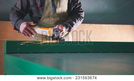 The Worker Male Grinding The Steel Mechanism On Industry, Close Up