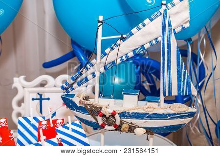 Modern Decoration For Birthday Party In Red, Blue And White Marine Style. Model Of Decorative Wooden