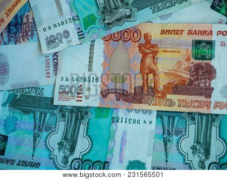 Scattered Ruble Banknotes And Coins Close Up