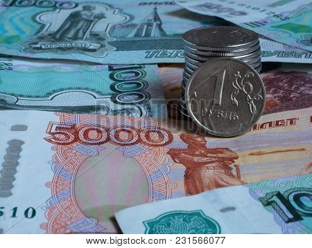 Several Russian Coins Lie On The Banknote