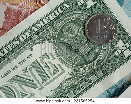Coin One Ruble On The Background Of The Us Dollar