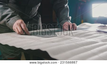 Worker Making Measurements And Marks On A Part By Means Of A Ruler, Industrial Concept