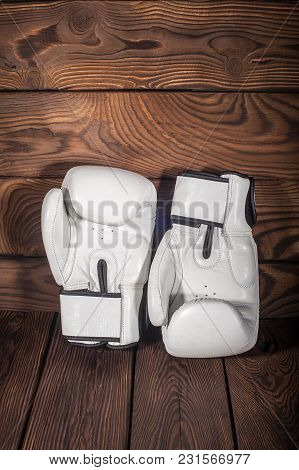 Boxing Gloves On Dark Brown Cracked Wooden Background, Empty Space