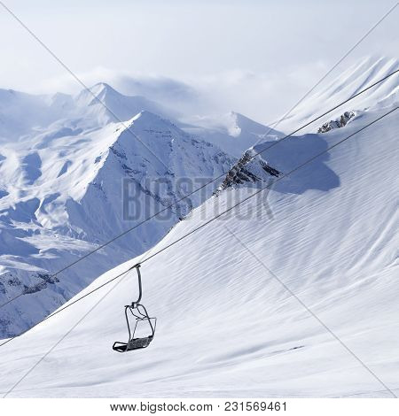 Chair Lifts And Off-piste Slope In Haze. Caucasus Mountains, Georgia, Region Gudauri.