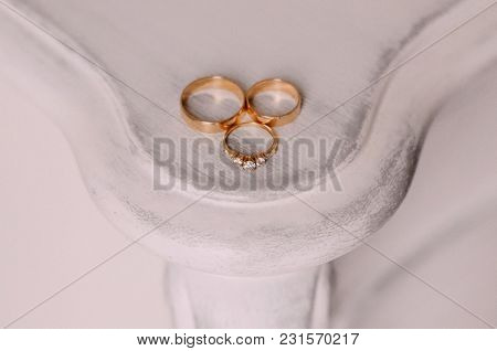 Beautiful Gold Rings Lie On A Textured  With An Wedding