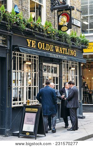 London, Uk- Mar 13, 2018: Office Workers Enjoy A Pint At Lunchtime At The Ye Olde Watling Pub In The