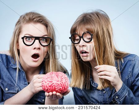 Friendship, Human Relations Concept. Two Crazy Women Friends Or Sisters Wearing Jeans Shirts And Eye