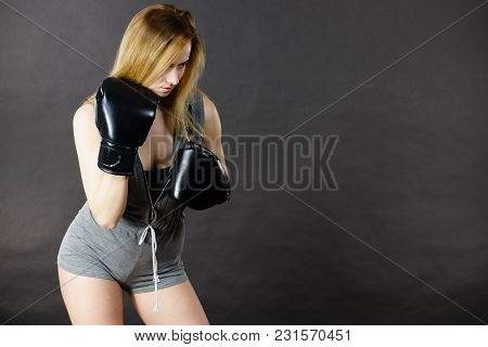 Sportsmanship Fairplay And Strong Body. Young Woman Fighting Boxing. Blonde Girl Wearing Black Punch