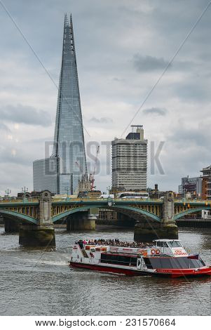 London, Uk- Mar 13, 2018: Shard Skyscraper And Southwark Bridge On River Thames. Citycruises Boat Pa