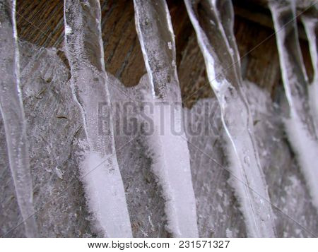 Icicles Covered With Snow Macro In Winter