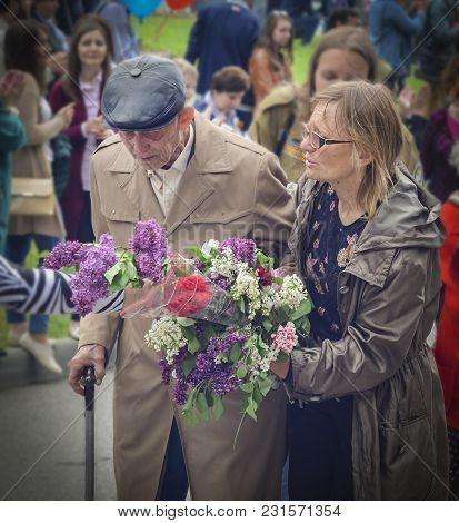 Pyatigorsk, Russia - May 09, 2017: Carer And Elderly Man With A Walking Stick On Victory Day On A Pa