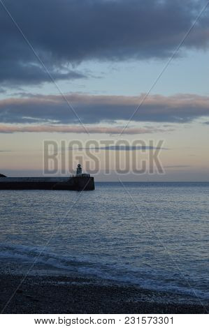 Harbor Wall And Lighthouse Of Laxey, Isle Of Man
