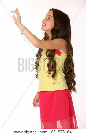 Pretty Brunette Slender Child With Chic Long Hair Is Artistically Posing In A Red Skirt With Bare Le