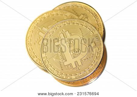 Three Golden Bitcoin Coins On White Background