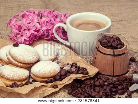 Spring Still-life From A Cup Of Coffee With Milk, Biscuits, A Flower On A Rough Background