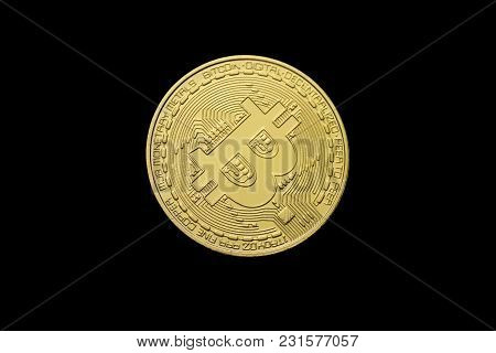 Close-up Of Golden Bitcoin On Black Background