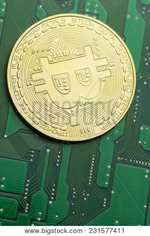 Close-up Of Golden Bitcoin On Green Printed Circuit Board