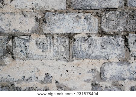 Gray Concrete Blocks Of Old Construction, Can Serve As A Vintage Background Or A Design Solution, Ma