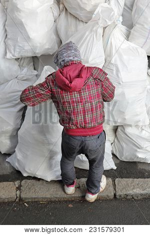Man Looking In White Sacks At Street