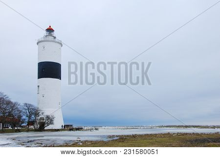 Winter Season At The Ottenby Lighthouse On The Swedish Island Oland In The Baltic Sea. A Famous Bird