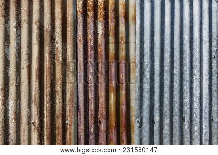 Old Rusty Galvanized Iron Plate Texture Background. Grunge Zinc Steel Rusty Wall Texture Background.