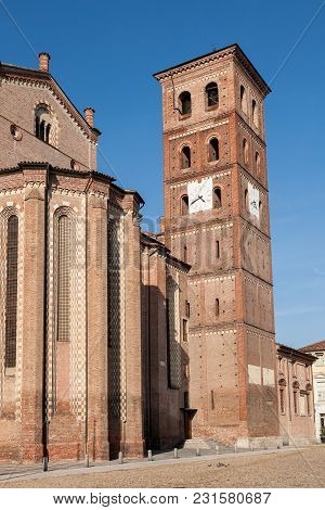 The Bell Tower And Exterior Of The 13th Century Cathedral Of The Town Of Asti In The Piedmont Region
