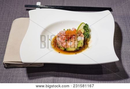 Tartare Of Sicilian Red Shrimps In Citrus Sauce Decorated With Orange Caviar And Slice Of Lime