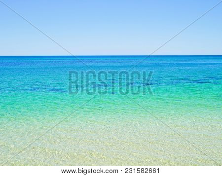 Crystal Clear Blue Ocean Water Background. Nature Background.