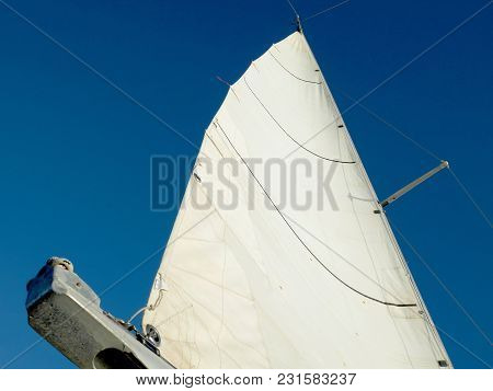White Sail On Blue Sky Background. Sport Concept.