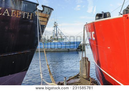New Bedford, Massachusetts, Usa - March 15, 2018: Fishing Vessel Retriever Framed By Vessels Jane El