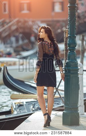 Travel Tourist Girl On Vacation Walking Happy By Grand Canal. Attractive Young Romantic Woman Standi