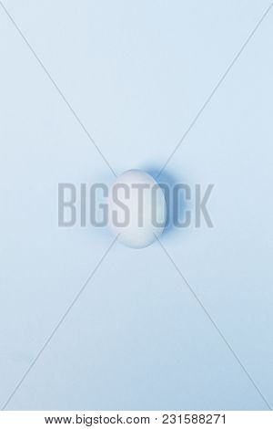 Blue Egg On Blue Background. Top View