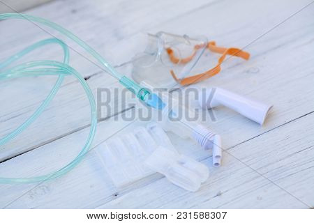 Sterile Albuterol Sulfate Vials With Nebulizer And Mouthpiece. It Is A Common Medication Name.