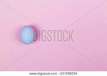 Blue Egg On Pink Background. Top View, Copy Space. Food Background