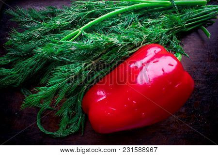 Fresh Vegetables - Red Pepper And Fresh Green Dill From The Vegetable Garden In Season, On A Dark Ba