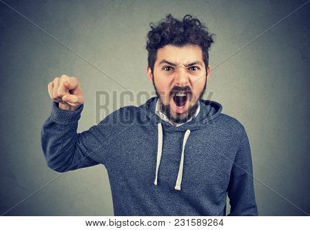 Angry Young Man Accusing Someone Screaming In Frustration
